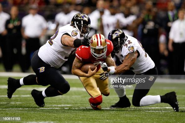 Colin Kaepernick of the San Francisco 49ers is tackled by Haloti Ngata and Ray Lewis of the Baltimore Ravens in the first quarter during Super Bowl...