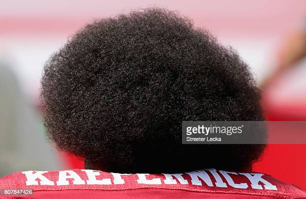 Colin Kaepernick of the San Francisco 49ers kneels during the national anthem before their game against the Carolina Panthers at Bank of America...
