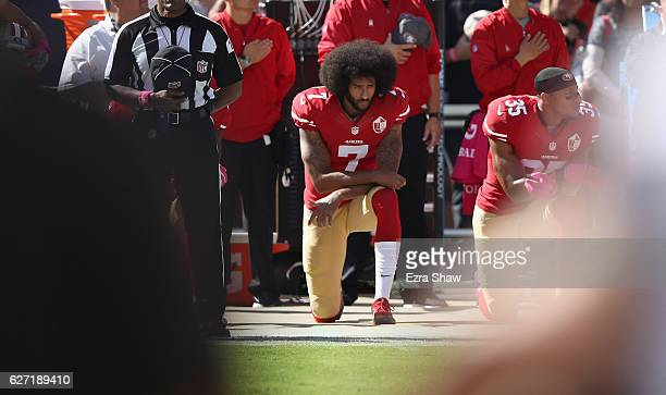 Colin Kaepernick of the San Francisco 49ers kneels for the National Anthem before their game against the Tampa Bay Buccaneers at Levi's Stadium on...