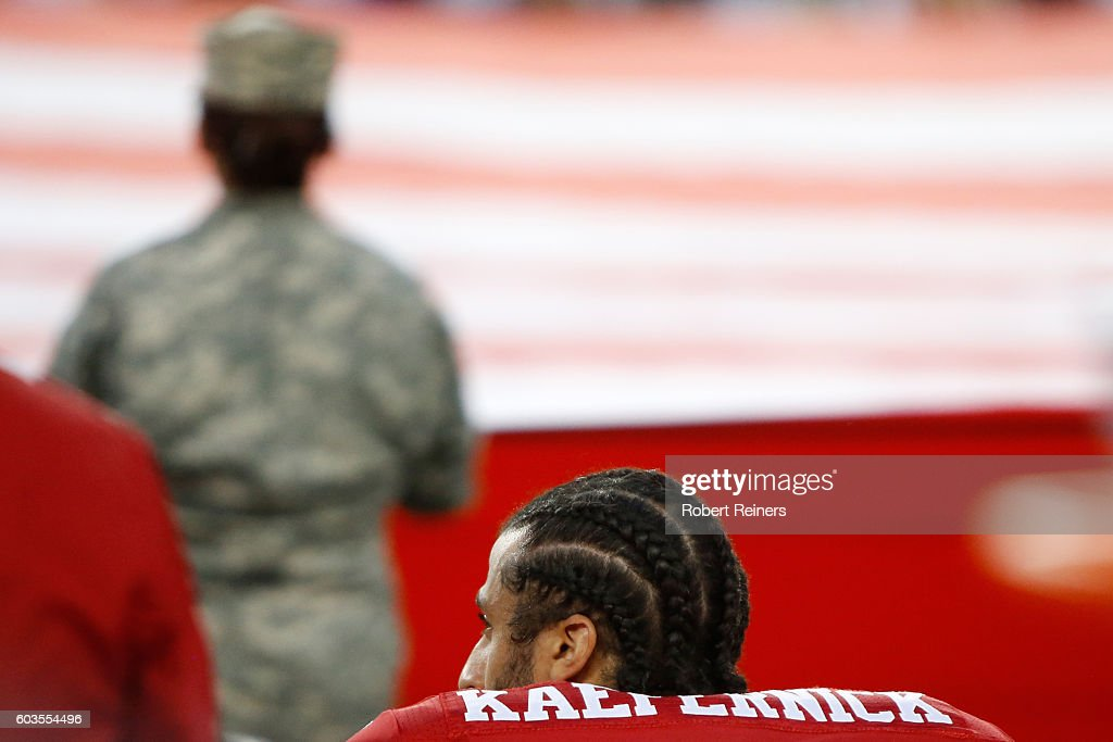 Colin Kaepernick #7 of the San Francisco 49ers kneels in protest during the national anthem prior to playing the Los Angeles Rams in their NFL game at Levi's Stadium on September 12, 2016 in Santa Clara, California.