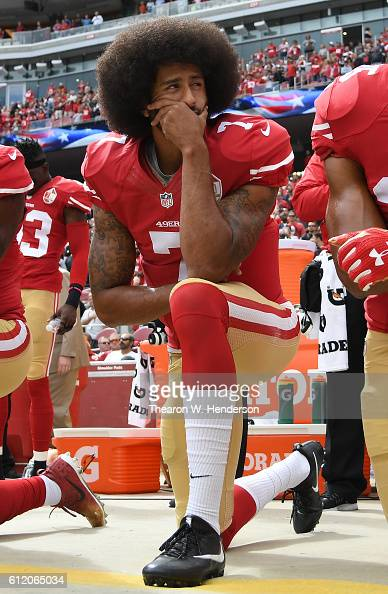 Colin Kaepernick of the San Francisco 49ers kneels on the sideline during the anthem prior to the game against the Dallas Cowboys at Levi's Stadium...