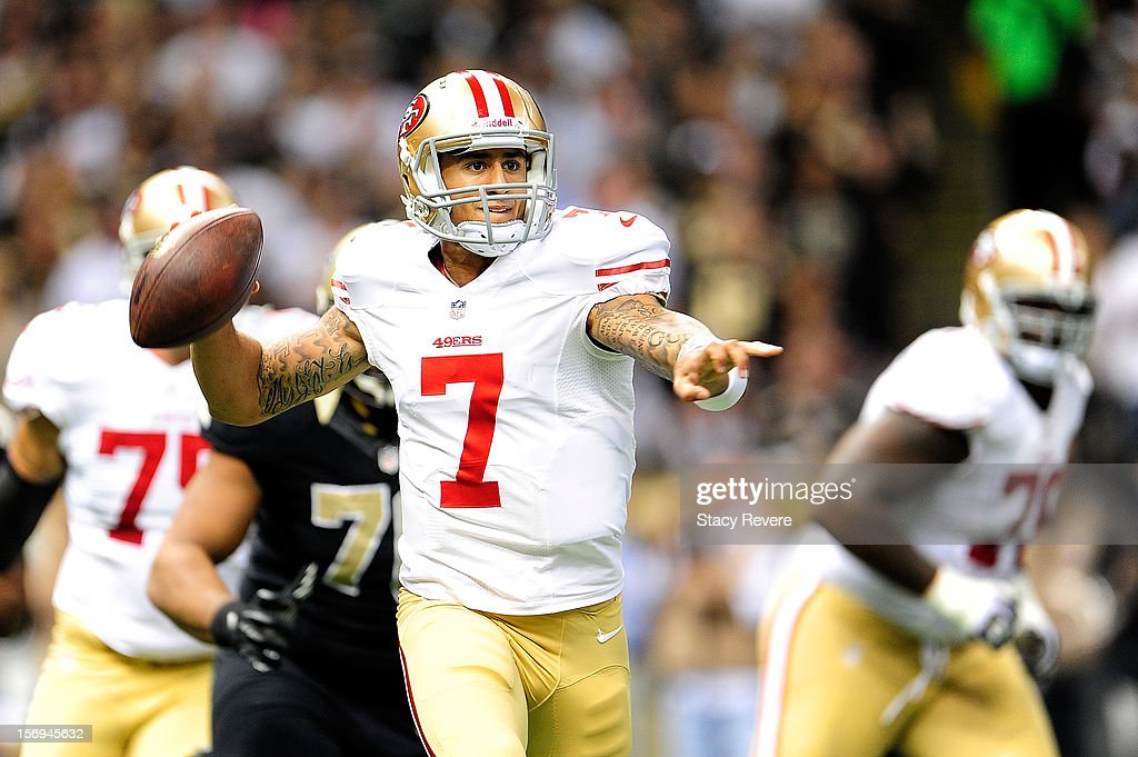 Colin Kaepernick #7 of the San Francisco 49ers looks for an open receiver during a game against the New Orleans Saints at the Mercedes-Benz Superdome on November 25, 2012 in New Orleans, Louisiana.