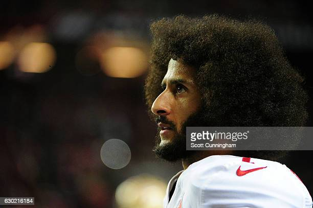 Colin Kaepernick of the San Francisco 49ers looks on from the sidelines during the second half against the Atlanta Falcons at the Georgia Dome on...
