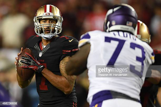 Colin Kaepernick of the San Francisco 49ers looks to pass the ball against the Minnesota Vikings during their NFL game at Levi's Stadium on September...