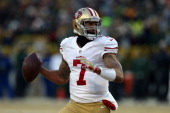 Colin Kaepernick of the San Francisco 49ers looks to throw a pass in the first quarter against the Green Bay Packers during their NFC Wild Card...