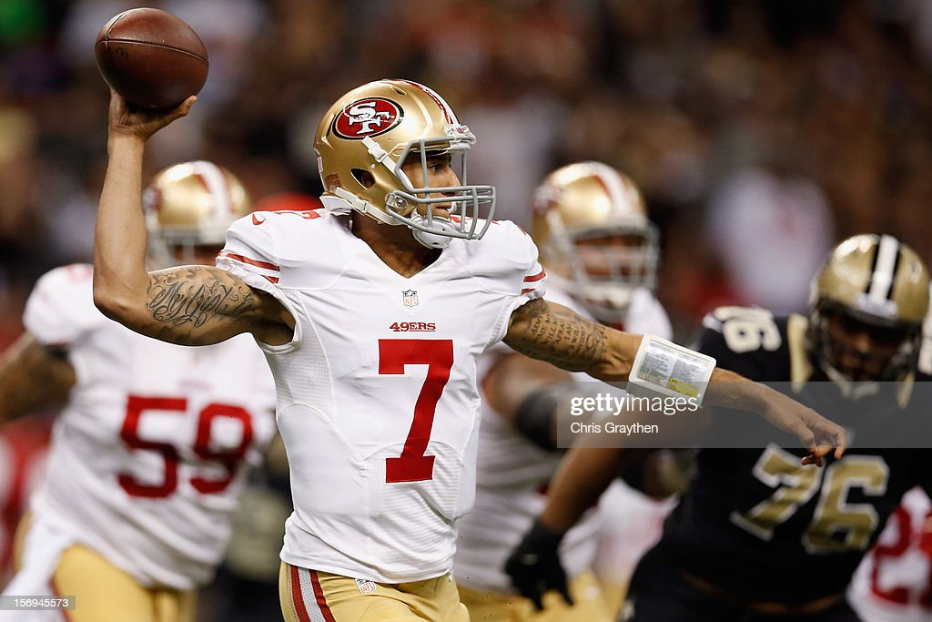 Colin Kaepernick #7 of the San Francisco 49ers looks to throw the ball against the New Orleans Saints at The Mercedes-Benz Superdome on November 25, 2012 in New Orleans, Louisiana.