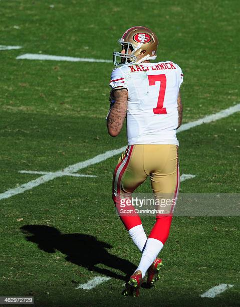 Colin Kaepernick of the San Francisco 49ers passes during the NFC Divisional Playoff Game against the Carolina Panthers at Bank of America Stadium on...