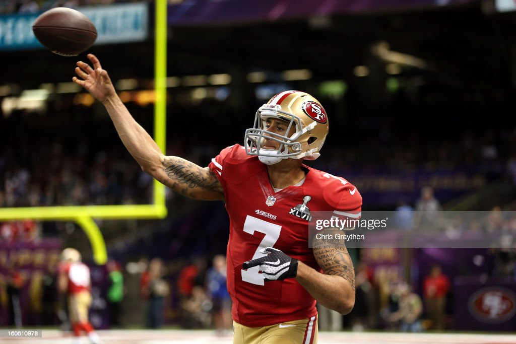 Colin Kaepernick #7 of the San Francisco 49ers passes the ball during warm ups prior to Super Bowl XLVII against the Baltimore Ravens at the Mercedes-Benz Superdome on February 3, 2013 in New Orleans, Louisiana.