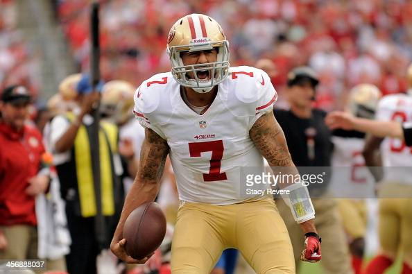 Colin Kaepernick of the San Francisco 49ers reacts to a first down against the Tampa Bay Buccaneers during a game at Raymond James Stadium on...