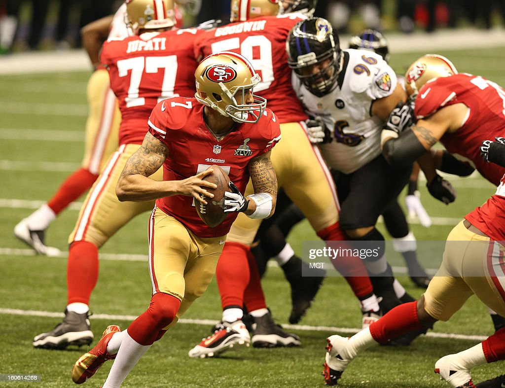 Colin Kaepernick (7) of the San Francisco 49ers rolls out of the pocket against the Baltimore Ravens during first-quarter action in Super Bowl XLVII at the Mercedes-Benz Superdome in New Orleans, Louisiana, Sunday, February 3, 2013.