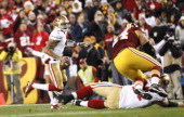 Colin Kaepernick of the San Francisco 49ers runs behind a Joe Staley block during the game against the Washington Redskins at FedEx Field on November...