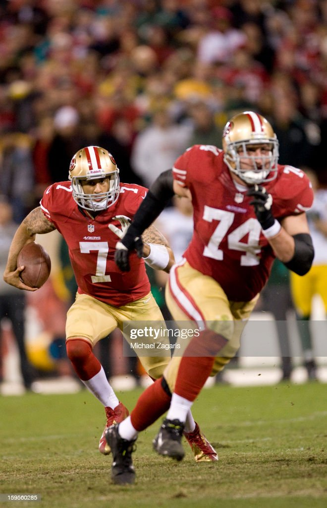 Colin Kaepernick #7 of the San Francisco 49ers runs behind Joe Staley #74 during the game against the Green Bay Packers at Candlestick Park on January 12, 2012 in San Francisco, California. The 49ers defeated the Packers 45-31.