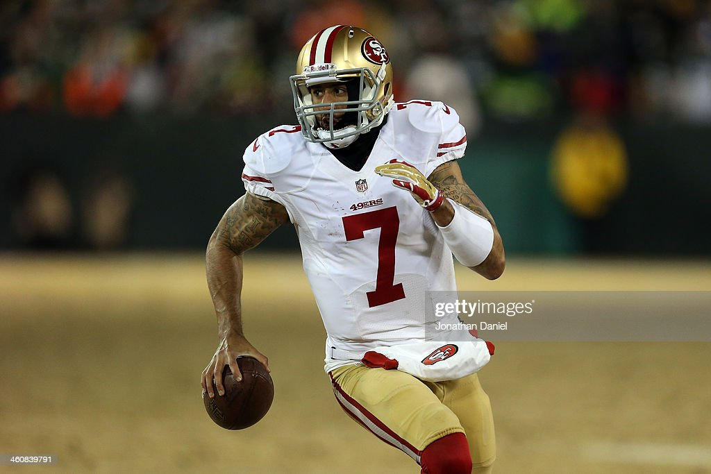 Colin Kaepernick of the San Francisco 49ers runs the ball for a first down in the fourth quarter against the Green Bay Packers during their NFC Wild...