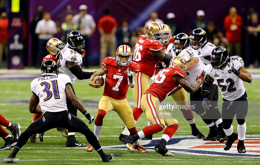 Colin Kaepernick #7 of the San Francisco 49ers runs with the ball in front of Bernard Pollard #31 of the Baltimore Ravens in the first quarter during Super Bowl XLVII at the Mercedes-Benz Superdome on February 3, 2013 in New Orleans, Louisiana.