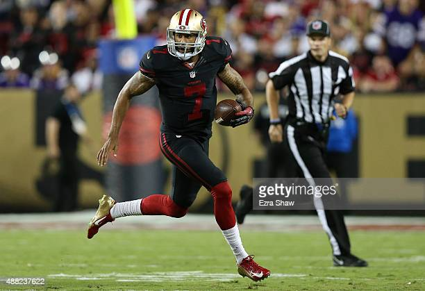 Colin Kaepernick of the San Francisco 49ers runs with the ball against the Minnesota Vikings during their NFL game at Levi's Stadium on September 14...