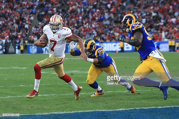 Colin Kaepernick of the San Francisco 49ers rushes for a 13yard touchdown during the fourth quarter as Aaron Donald and Alec Ogletree of the Los...