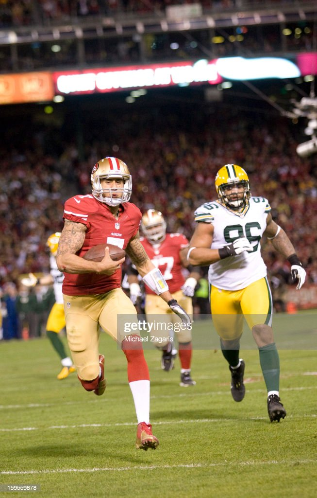 Colin Kaepernick #7 of the San Francisco 49ers rushes for a 20-yard touchdown during the game against the Green Bay Packers at Candlestick Park on January 12, 2012 in San Francisco, California. The 49ers defeated the Packers 45-31.