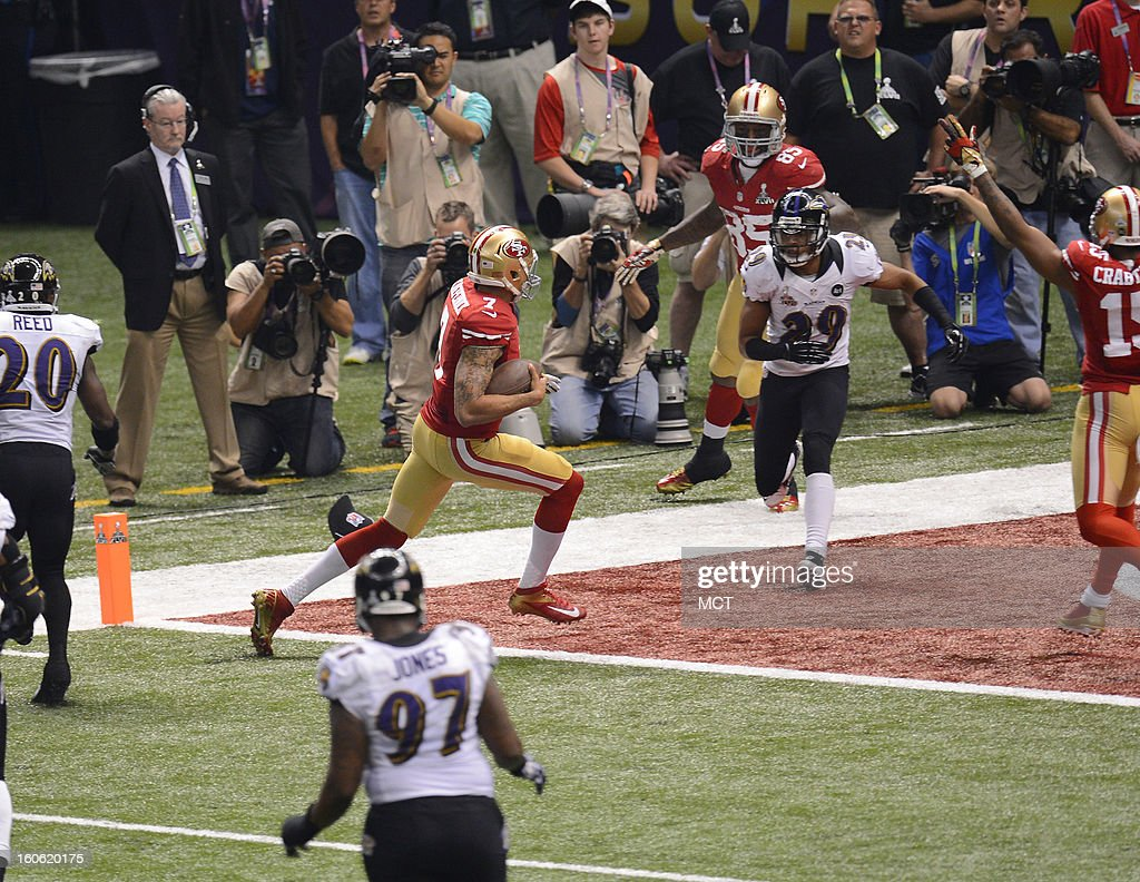 Colin Kaepernick (7) of the San Francisco 49ers scrambles for a touchdown against the Baltimore Ravens in Super Bowl XLVII at the Mercedes-Benz Superdome in New Orleans, Louisiana, Sunday, February 3, 2013.