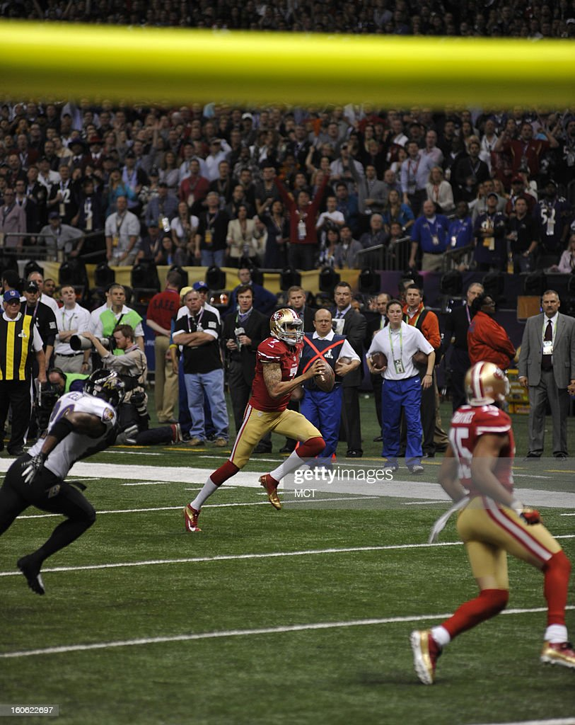 Colin Kaepernick (7) of the San Francisco 49ers scrambles for a touchdown in the fourth quarter of Super Bowl XLVII at the Mercedes-Benz Superdome in New Orleans, Louisiana, Sunday, February 3, 2013.