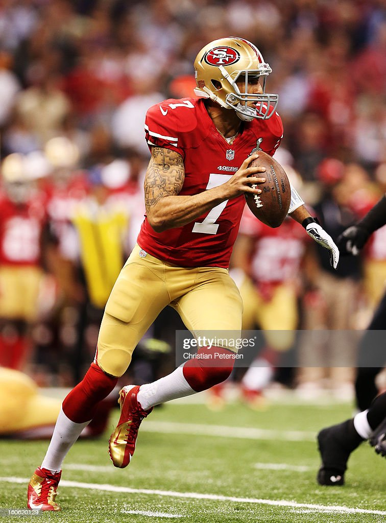 Colin Kaepernick #7 of the San Francisco 49ers scrambles with the ball against the Baltimore Ravens during Super Bowl XLVII at the Mercedes-Benz Superdome on February 3, 2013 in New Orleans, Louisiana.