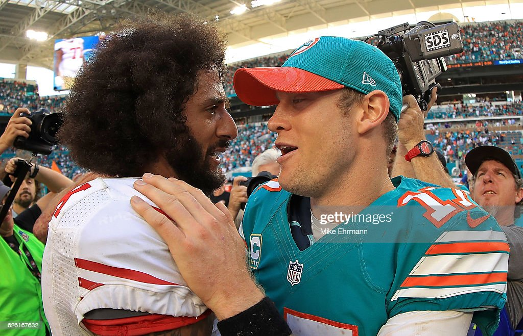 Colin Kaepernick #7 of the San Francisco 49ers shakes hands with Ryan Tannehill #17 of the Miami Dolphins during a game on November 27, 2016 in Miami Gardens, Florida.
