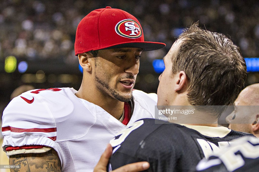 <a gi-track='captionPersonalityLinkClicked' href=/galleries/search?phrase=Colin+Kaepernick&family=editorial&specificpeople=5525694 ng-click='$event.stopPropagation()'>Colin Kaepernick</a> #7 of the San Francisco 49ers talks after the game to Dree Brews #9 of the New Orleans Saints at Mercedes-Benz Superdome on November 17, 2013 in New Orleans, Louisiana. The Saints defeated the 49ers 23-20.
