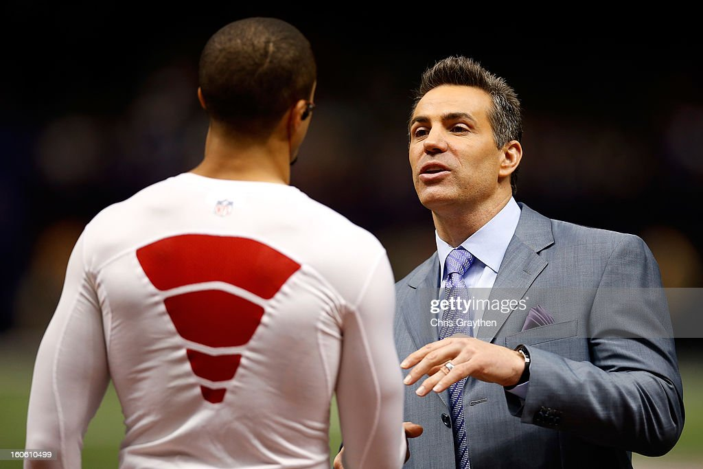 Colin Kaepernick #7 of the San Francisco 49ers talks with former professional football player and quarterback, Kurt Warner, on the field prior to Super Bowl XLVII at the Mercedes-Benz Superdome on February 3, 2013 in New Orleans, Louisiana.
