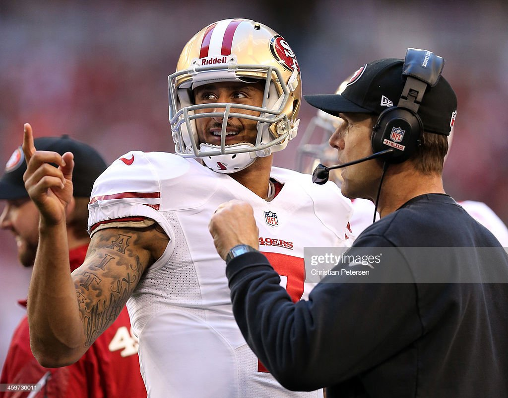 <a gi-track='captionPersonalityLinkClicked' href=/galleries/search?phrase=Colin+Kaepernick&family=editorial&specificpeople=5525694 ng-click='$event.stopPropagation()'>Colin Kaepernick</a> #7 of the San Francisco 49ers talks with head coach <a gi-track='captionPersonalityLinkClicked' href=/galleries/search?phrase=Jim+Harbaugh&family=editorial&specificpeople=779595 ng-click='$event.stopPropagation()'>Jim Harbaugh</a> on the sidelines against the Arizona Cardinals during a game at University of Phoenix Stadium on December 29, 2013 in Glendale, Arizona.