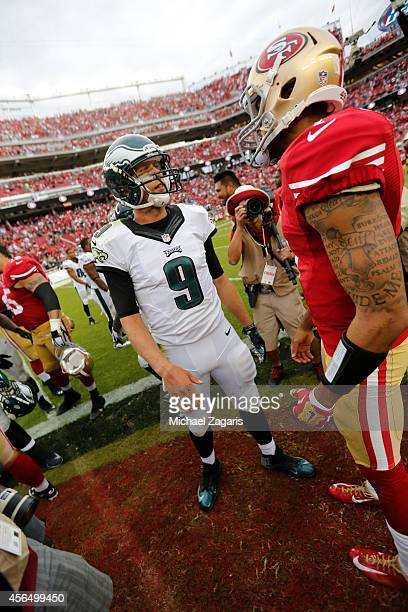 Colin Kaepernick of the San Francisco 49ers talks with Nick Foles of the Philadelphia Eagles following the game at Levi Stadium on September 28 2014...