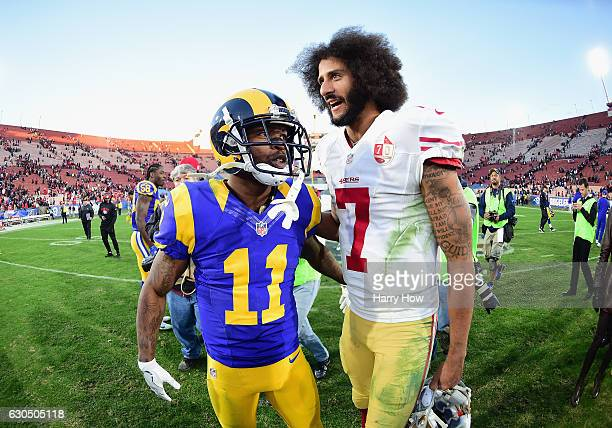 Colin Kaepernick of the San Francisco 49ers talks with Tavon Austin of the Los Angeles Rams after the 49ers defeated the Rams 2221 at Los Angeles...