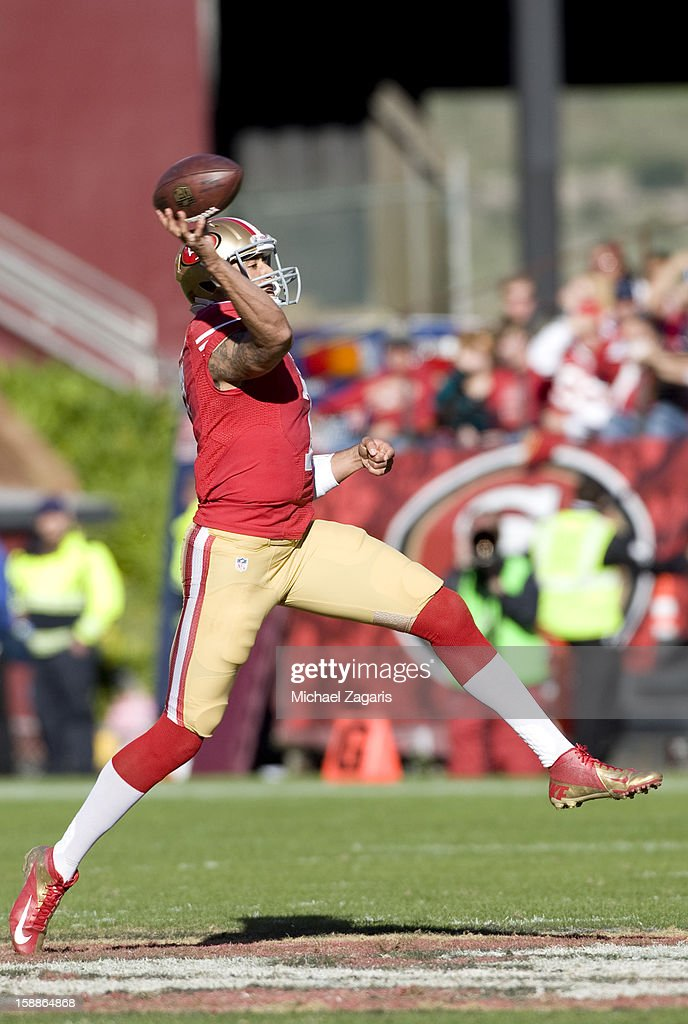 Colin Kaepernick #7 of the San Francisco 49ers throws a 49-yard touchdown pass during the game against the Arizona Cardinals at Candlestick Park on December 30, 2012 in San Francisco, California. The 49ers defeated the Cardinals 27-13.