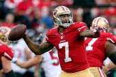 Colin Kaepernick of the San Francisco 49ers throws a pass against the Houston Texans during their game at Candlestick Park on October 6 2013 in San...