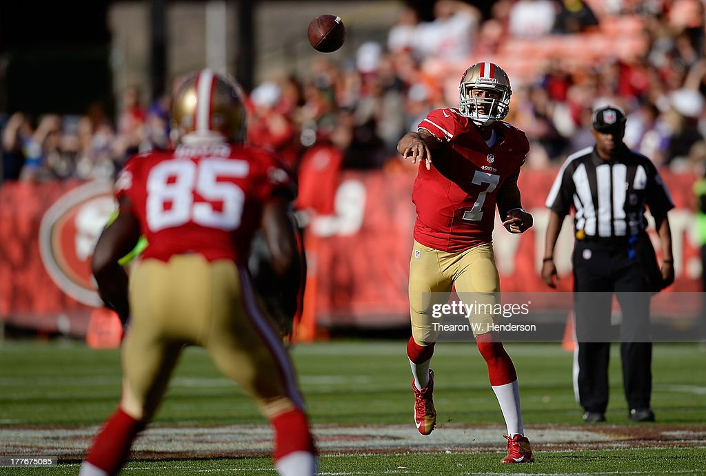 <a gi-track='captionPersonalityLinkClicked' href=/galleries/search?phrase=Colin+Kaepernick&family=editorial&specificpeople=5525694 ng-click='$event.stopPropagation()'>Colin Kaepernick</a> #7 of the San Francisco 49ers throws a pass to tightend <a gi-track='captionPersonalityLinkClicked' href=/galleries/search?phrase=Vernon+Davis&family=editorial&specificpeople=592553 ng-click='$event.stopPropagation()'>Vernon Davis</a> #85 in the first quarter against the Minnesota Vikings at Candlestick Park on August 25, 2013 in San Francisco, California.