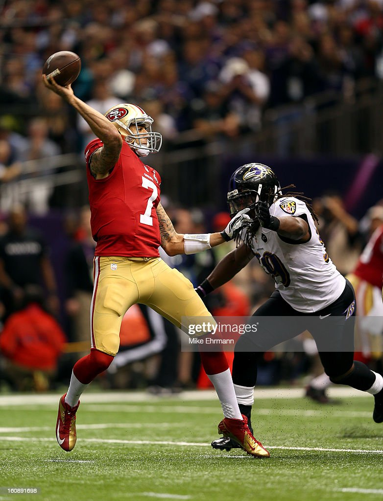 Colin Kaepernick #7 of the San Francisco 49ers throws a pass under pressure from Dannell Ellerbe #59 of the Baltimore Ravens during Super Bowl XLVII at the Mercedes-Benz Superdome on February 3, 2013 in New Orleans, Louisiana. The Ravens won 34-31.