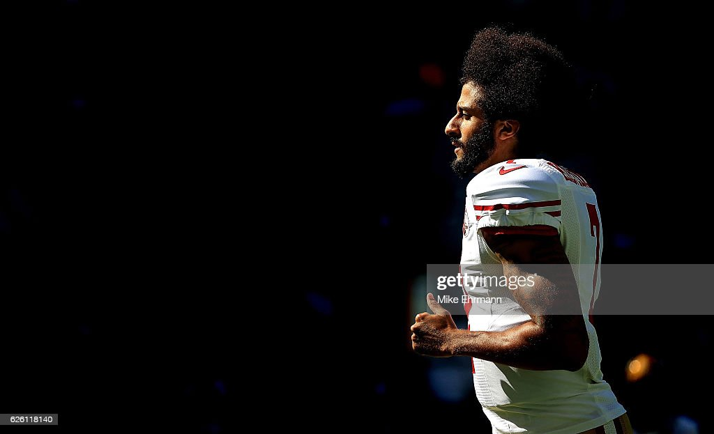 Colin Kaepernick #7 of the San Francisco 49ers warms up during a game against the Miami Dolphins on November 27, 2016 in Miami Gardens, Florida.