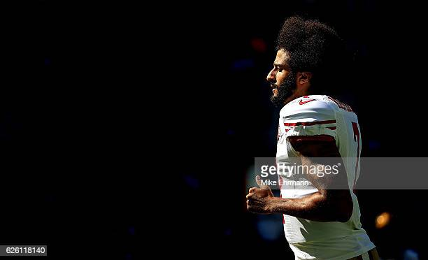 Colin Kaepernick of the San Francisco 49ers warms up during a game against the Miami Dolphins on November 27 2016 in Miami Gardens Florida