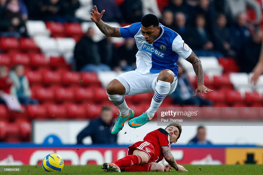 <a gi-track='captionPersonalityLinkClicked' href=/galleries/search?phrase=Colin+Kazim-Richards&family=editorial&specificpeople=684189 ng-click='$event.stopPropagation()'>Colin Kazim-Richards</a> of Blackburn in action with James Wilson of Bristol City during the FA Cup with Budweiser Third Round match between Blackburn Rovers and Bristol City at Ewood Park on January 5, 2013 in Blackburn, England.