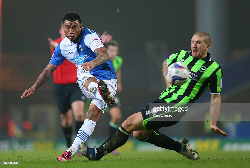 Colin Kazim-Richards of Blackburn Rovers gets a shot in past Adam El-Abd of Brighton & Hove Albion during the npower Championship match between Blackburn Rovers and Brighton & Hove Albion at Ewood park on January 22, 2013 in Blackburn, England.