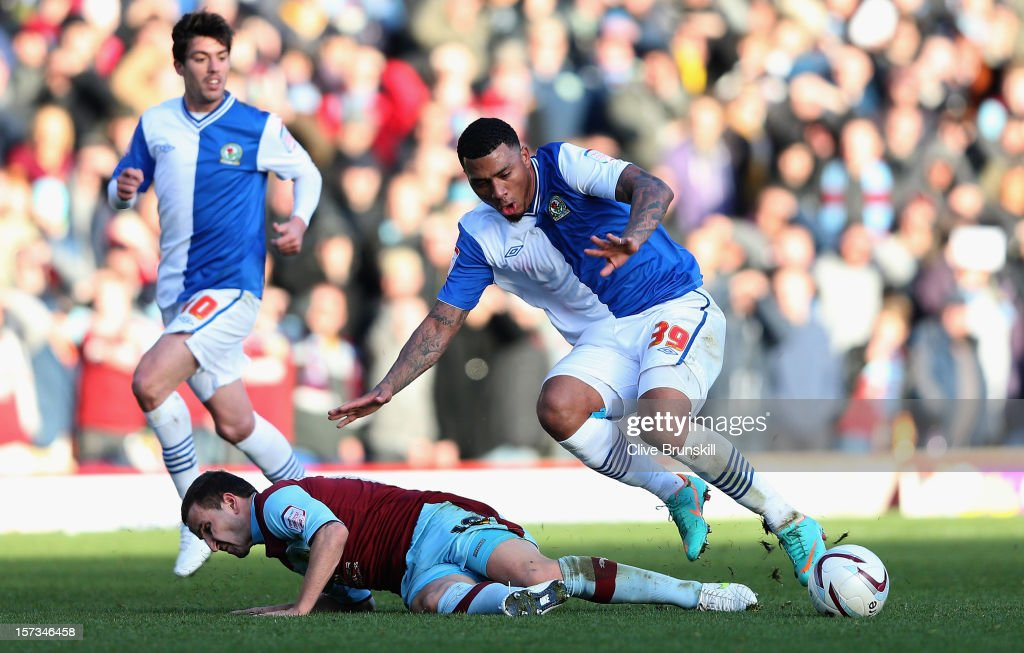 <a gi-track='captionPersonalityLinkClicked' href=/galleries/search?phrase=Colin+Kazim-Richards&family=editorial&specificpeople=684189 ng-click='$event.stopPropagation()'>Colin Kazim-Richards</a> of Blackburn Rovers is tackled by Martin Paterson of Burnley during the npower Championship match between Burnley and Blackburn Rovers at Turf Moor on December 2, 2012 in Burnley, England.