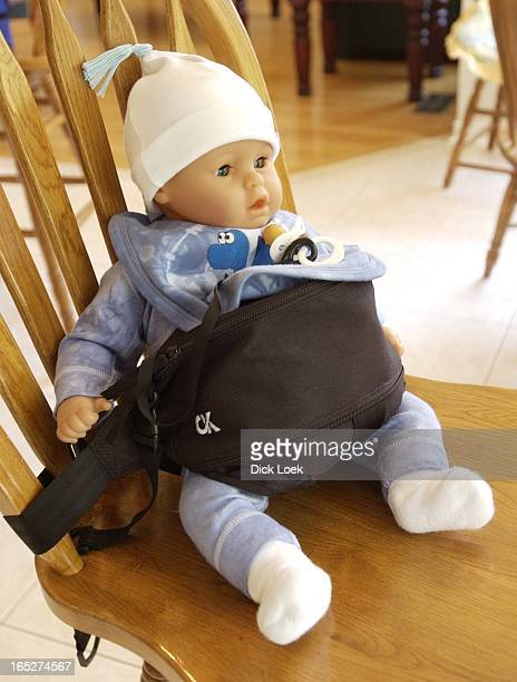 Colin Knauf042302 Colin Knauf created the Cuddle Karrier an adjustable Baby Sling mini diaper bag travel high chair and shopping cart restrainer His...