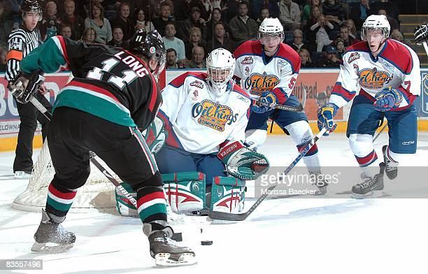 Colin Long of the Kelowna Rockets takes a shot on Torrie Jung Tyler Hlookoff and Henrik Tervonen of the Edmonton Oil Kings at the Kelowna Rockets on...