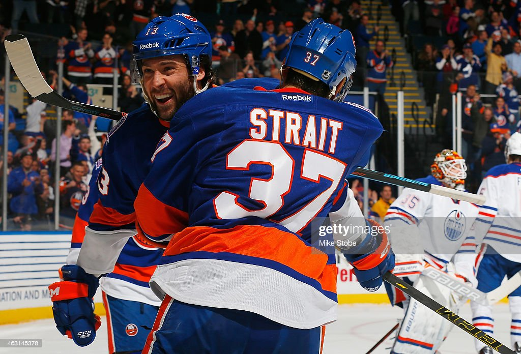 Colin McDonald #13 of the New York Islanders is congratulated by teammate Brian Strait #37 after scoring a first period goal against the Edmonton Oilers at Nassau Veterans Memorial Coliseum on February 10, 2015 in Uniondale, New York.