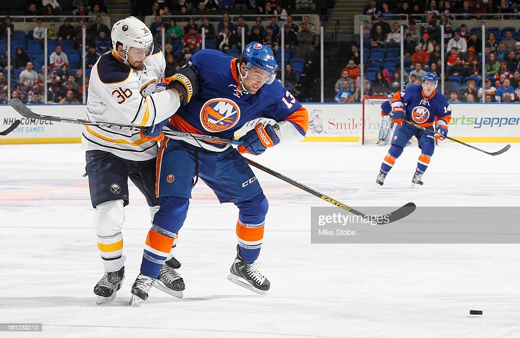 Colin McDonald #13 of the New York Islanders pursues the puck against Patrick Kaleta #36 of the Buffalo Sabres at Nassau Veterans Memorial Coliseum on Febuary 9, 2013 in Uniondale, New York.