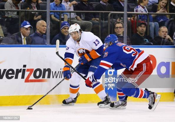 Colin McDonald of the New York Islanders skates against Matt Gilroy of the New York Rangers during their game at Madison Square Garden on February 7...