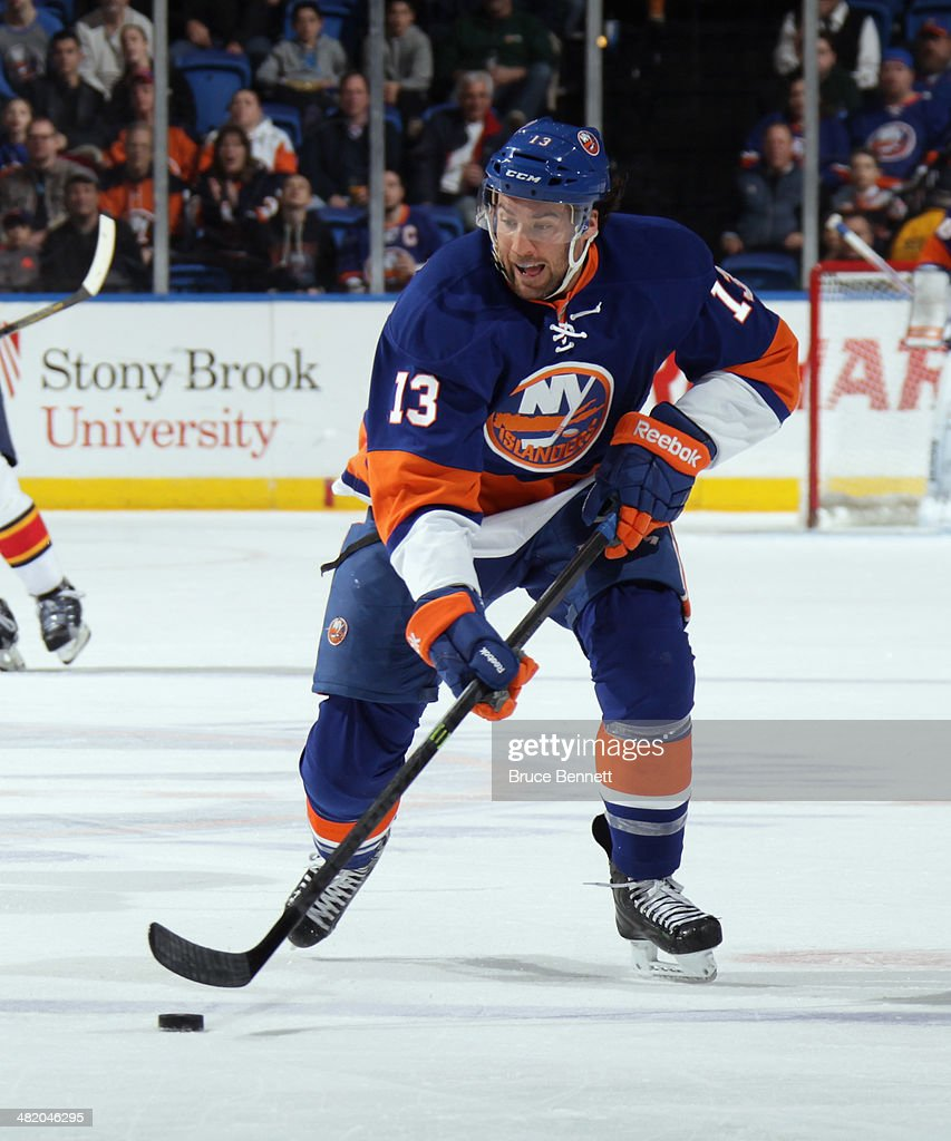 Colin McDonald #13 of the New York Islanders skates against the Florida Panthers at the Nassau Veterans Memorial Coliseum on April 1, 2014 in Uniondale, New York. The Islanders defeated the Panthers 4-2.
