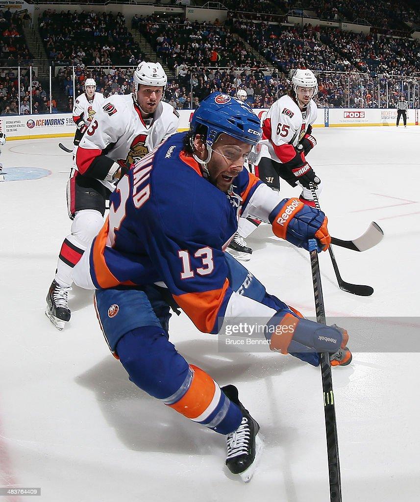 Colin McDonald #13 of the New York Islanders skates against the Ottawa Senators at the Nassau Veterans Memorial Coliseum on April 8, 2014 in Uniondale, New York.