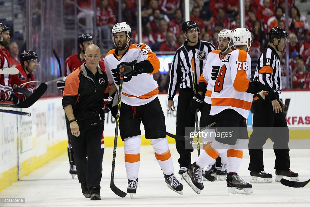 <a gi-track='captionPersonalityLinkClicked' href=/galleries/search?phrase=Colin+McDonald+-+Ice+Hockey+Player&family=editorial&specificpeople=10833458 ng-click='$event.stopPropagation()'>Colin McDonald</a> #36 of the Philadelphia Flyers is helped off the ice after taking a hit by the Washington Capitals in the second period of Game Five of the Eastern Conference Quarterfinals during the 2016 NHL Stanley Cup Playoffs at Verizon Center on April 22, 2016 in Washington, DC.