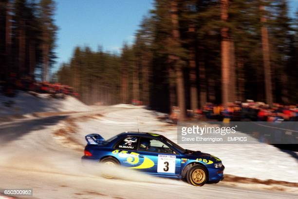 Colin McRae drives through the forests of Sagen rduring the Swedish Rally