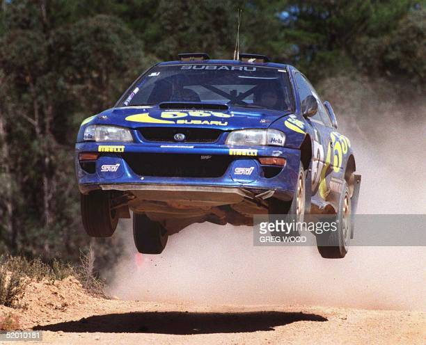 Colin McRae of Great Britain in full flight on his way to winning Rally Australia in Perth 02 November McRae won by six seconds over defending World...