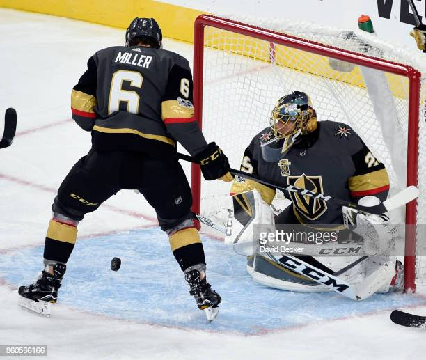 Colin Miller and goalie MarcAndre Fleury of the Vegas Golden Knights deflect a shot on goal from the Arizona Coyotes at TMobile Arena on October 10...